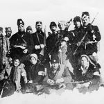 Капетан Михајло Бабић, командант бригаде у Првом личком корпусу, са дивизијским лекаром др Вељком Чворком и групом херцеговачких четника, у зиму 194243. Седе, болничарке Ленка Продановић, Милка Новаковић и Боја Стојсављевић