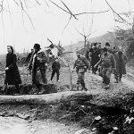Дража на венчању наредника Гојка Ајваза, у селу Врањска испод Равне Горе, вероватно марта 1944. Кум је био амерички капетан Yорy Мусулин (иза Драже). Младу води поручник Благоје Ковач