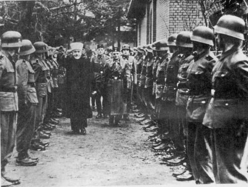 "The Grand Mufti of Jerusalem revieiwing the Bosnian Muslim 13 th Waffen Gebirgs Division der ""Handzar"" with SS Brigadefuehrer and Generalmajor of the Waffen Karl Gustav Sauberzweig"