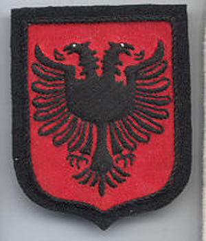 Skanderbeg SS Division arm patch showingthe Albanian national flag, the same arm patch of the KLA 50 yers later.