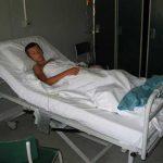 Рањени Марко Богићевић (старост 11) у војној пољској болници у Призрену.