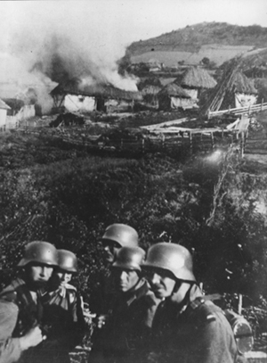 German Wehrmacht troops burning Serbian villages near Kosovska Mitrovica in 1941.