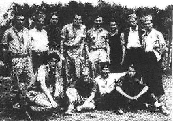 "Brothers-in-arms: a group of young soldiers from the 501/12 Staff of the Kolubara Corps, surrounding rescued Americans in June, 1944. Standing, from left to right: Ivan Mihailovic ""Virga"", Zika Zivadinovic, Bogdan Belie ""Logos"", Lt. Donald Parkerson, USAF, Lt. Fred Barrett, Voja Petrovic, Group commander, Stanislav Sondermayer, Mihailo Celegin ""Gica"". Sitting: Milan Djuric, Ljubomir Rimsa, Dragan Simic ""Jelenko"", Mihailo Sondermayer. ""Our group rescued two airmen from a damaged Liberator. The commander was captured by the SS and Volunteer troops. The rest of the crew parachuted a few miles further and were saved. We managed to push Parkerson and Barrett through a German blockade and to send them under difficult conditions to the Pranjani air­field, from where they were to be flown to Italy."" Mihailo Sondermayer, Geneva, May 22, 1995."
