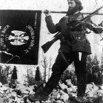 Потпоручник (пре рата активни нарeдник) Драгиша Ђорђевић из с. Буровац код Петровца на Млави, са заставом 3. млавске бригаде Млавског корпуса. Драгиша је нестао ујесен 1944, када су немачки авиони бомбардовали његову јединицу, приликом преласка Велике Мораве, скелом, код Гложана (Фотографију је послао његов брат Радиша Ђорђевић)