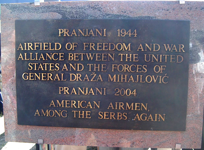 "Plaque in Pranjani dedicated to the Halyard Mission on September 12, 2004. The plaque next to it reflects the same inscription in the Serbian language. Photo courtesy of OSS Halyard Mission radioman Arthur ""Jibby"" Jibilian"
