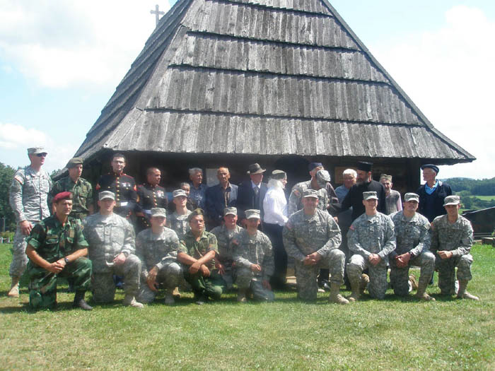 Ohio National Guard troops that are in Serbia doing work on schools in South Serbia. They are working with Serb soldiers, some of which are also in the photo. The older folks are those who participated in assisting the American airmen in 1944. Pranjani, Serbia Aug. 15, 2009.  Photo courtesy of Lt. Col. John Cappello.
