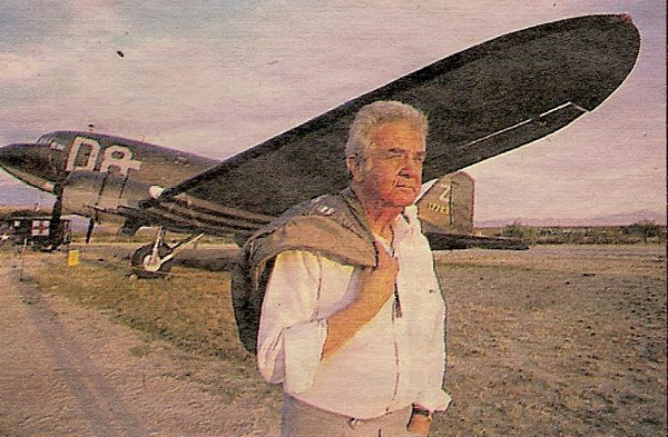 Photo of Major Richard Felman, U.S.A.F. (Ret.) by Mari Shaefer. Richard L. Felman stands before a Douglas C-47 Sky Train, a plane similar to the C-47 transports used to evacuate 500 U.S. fliers from Yugoslavia during World War II. The photo was taken at Pima Air Museum in Tucson, Arizona.