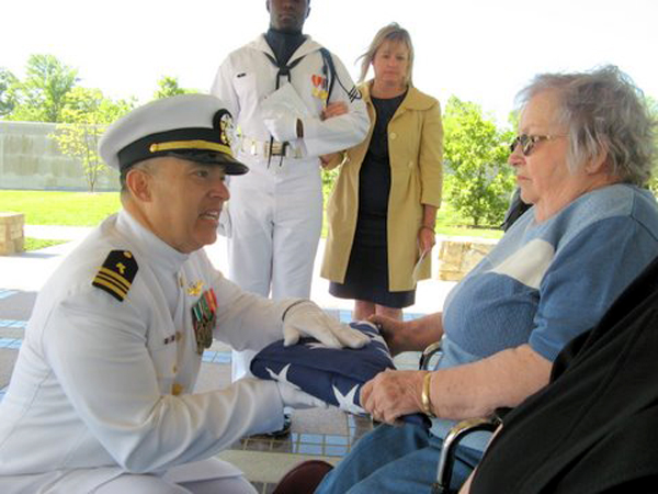 Jo Jibilian, wife of Arthur, accepts the American Flag from the Chaplain Arlington National Cemetery May 5, 2011