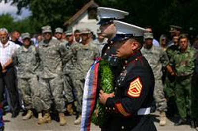 PRANJANI, Serbia // Marine Security Guards for the U.S. Embassy in Belgrade, Serbia, Lance Aaron Johnston and Gunnery Sgt. Laureano Perez, lay a wreath at the Halyard Mission memorial in Pranjanje, Serbia, August 2009 during the 65th annivesary of the Halyard Mission