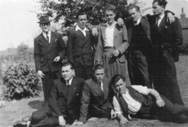Displaced Yugoslavs enjoying the sun in the grounds of Saville Park, adjacent to the Miner's Hostel. Maksim Ćulumović at front, far right