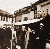 Kosovar Albanian Nazis with a swastika flag in Pec, 1944