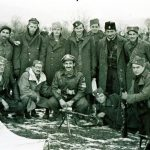 Final evacuation: Nick Lalich, kneeling front center, Dec. 27, 1944, before departing to Bari, Italy. Arthur Jibilian is standing second from left (facing photo), with the last of the American airmen to be evacuated from Yugoslavia.